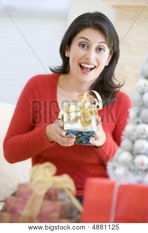 Woman Excited To Open Christmas Present