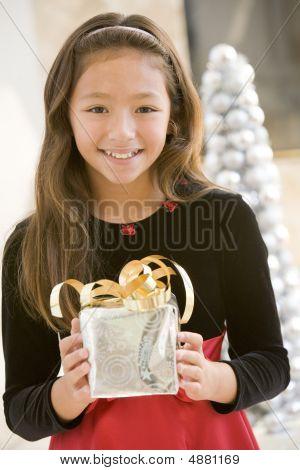 Young Girl Smiling,holding Christmas Gift