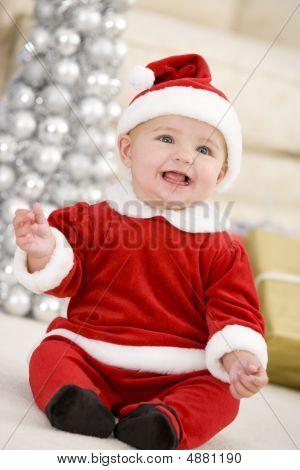 Baby In Santa Costume At Christmas