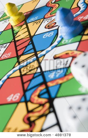 Close -up Of Snakes And Ladders Board