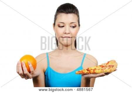 Female Choose Between Pizza And Orange