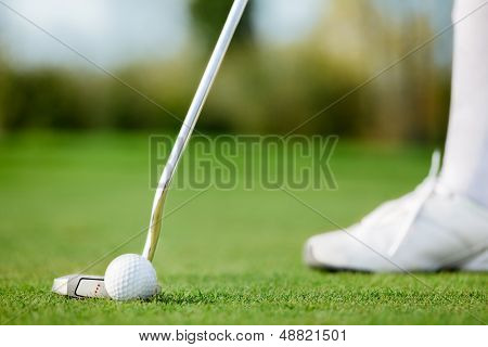 Golfer making short putt