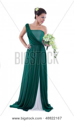 Romantic young woman beauty wearing fashion dress holding a bouquet of flowers