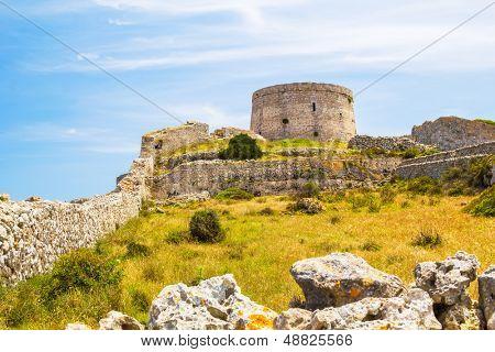 Torre d'??en Penjat uncared fort scenery at Menorca, Spain