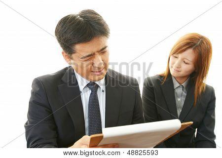 Dissatisfied businessman and businesswoman