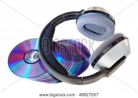 Modern Wireless Headphones On A Pile Of Cds And Dvds. On A White Background.