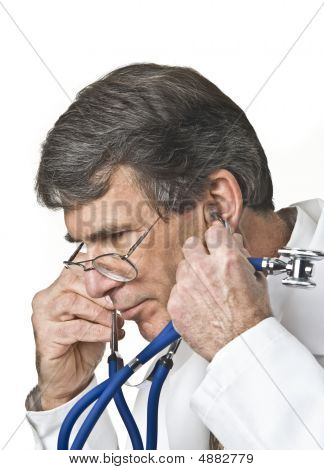 Doctor Listening Through Stethoscope