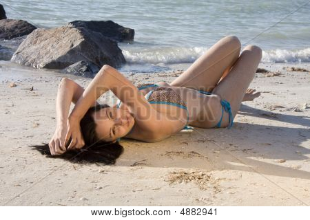 Pretty Girl Laying On The Sand