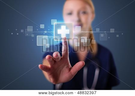 Pretty young nurse pressing modern medical type of buttons