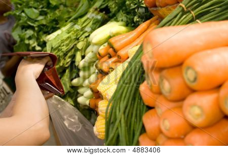 Woman Buying Vegetables At The Market