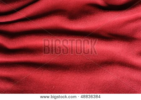 red wool background with folds