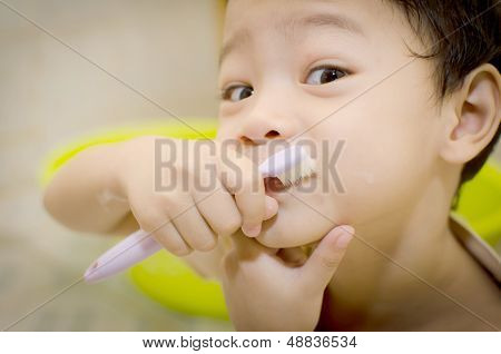 Young Boy Brushing His Teeth; 3 Years Old
