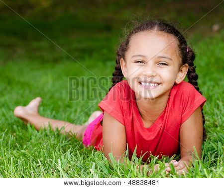 Summer portrait of pretty mixed race girl outdoors in natural setting