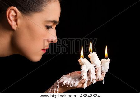 Three Candle Sticks On Fingers Buring With Wax Flow Face Blow