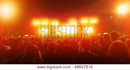 Rock concert, crowd of young people enjoying music in nightclub, holiday celebrations, dance club, red illumination, active lifestyle
