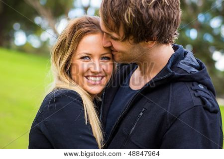 Happy young attractive smiling couple enjoy their time outdoor