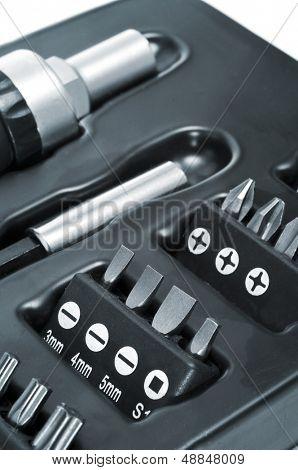 closeup of a set of detachable tip screwdriver and screwdriver bits