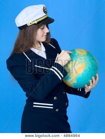 Woman In Sea Uniform And Globe