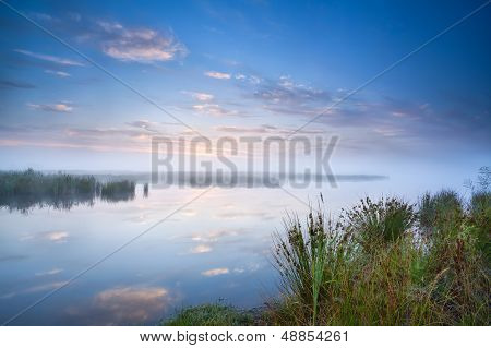 Calm Misty Morning Over Lake