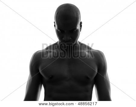 one african  black man topless looking down sad  in silhouette studio on white background