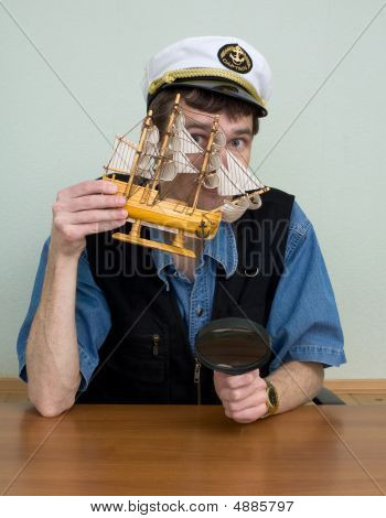 Man In Uniform Cap With Sailer