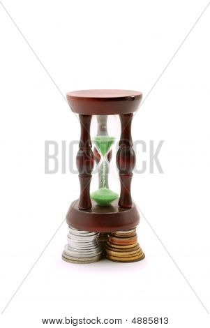 Sand Watch And Background Of Coins