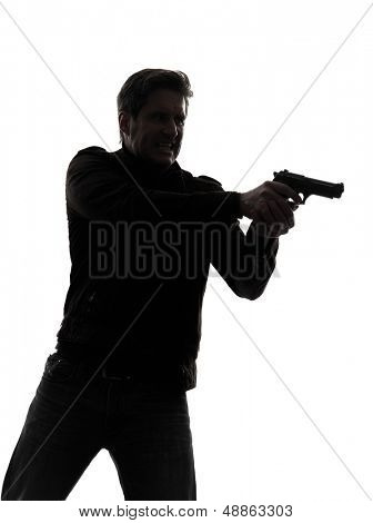 one man killer policeman aiming gun portrait silhouette studio white background