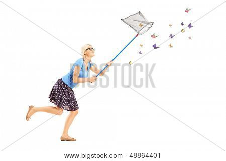 Full length portrait of a woman running and catching butterflies with net isolated on white background