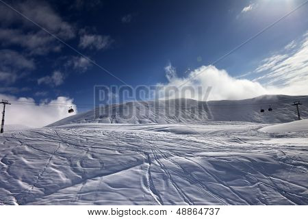 Off-piste Ski Slope And Gondola Lift