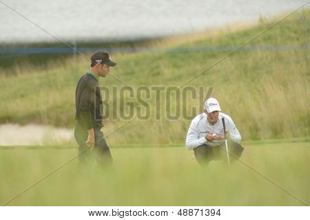 MOSCOW, RUSSIA - JULY 27: James Kingston of South Africa (right) and Jean-Baptiste Gonnet of France during 3rd round of M2M Russian Open at Tseleevo Golf & Polo Club in Moscow, Russia on July 27, 2013
