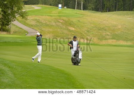 MOSCOW, RUSSIA - JULY 28: Simon Dyson of England with his caddie during final round of the M2M Russian Open at Tseleevo Golf & Polo Club in Moscow, Russia on July 28, 2013