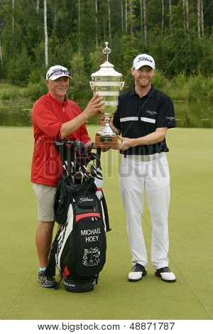 MOSCOW, RUSSIA - JULY 28: Michael Hoey of Northern Ireland and his caddie with the trophy of the M2M Russian Open at Tseleevo Golf & Polo Club in Moscow, Russia on July 28, 2013