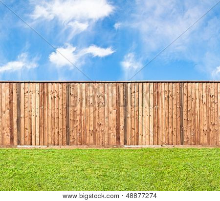 Wooden Fence At The Grass