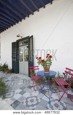 Chairs and table on porch of 19th century town house
