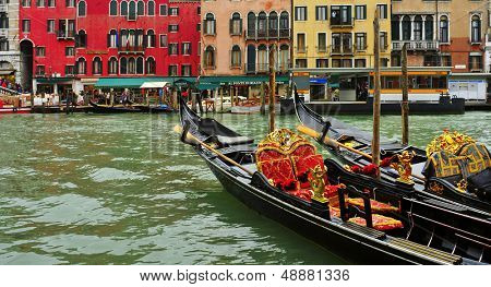 VENICE, ITALY - APRIL 12: Some gondolas in the Grand Canal on April 12, 2013 in Venice, Italy. This main canal is 3800 meter long, 30-90 meters wide, with an average depth of 5 meters