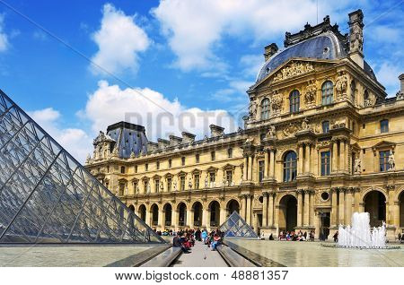 PARIS, FRANCE- MAY 17: The large glass pyramid and the main courtyard of the Louvre Museum on May 17, 2013. The Louvre Museum is one of the largest museums of the world