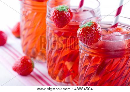 Glasses Of Red Strawberry Juice On Vintage Towel