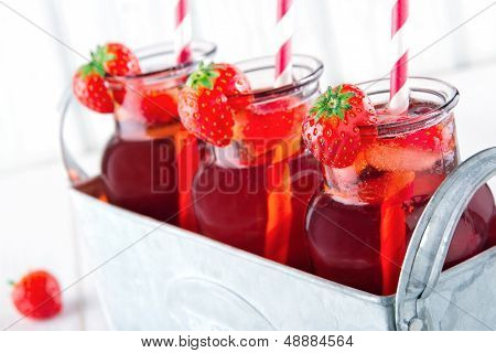 Glasses Of Red Strawberry Juice With Frozen Icecubes