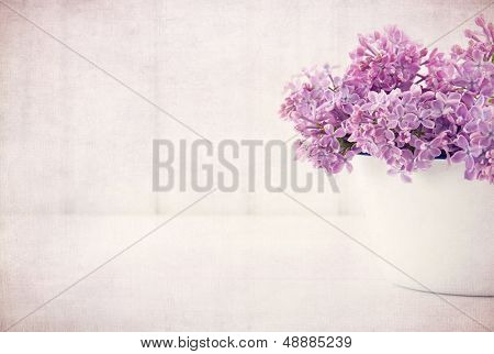 Purple Lilac Spring Flowers On Vintage Textured Background