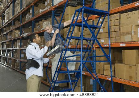 Multiethnic men working in distribution warehouse
