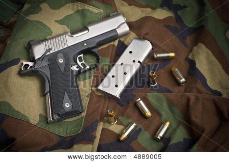45 Firearm Pistol Clip And Hand Gun Ammunition On Camouflage