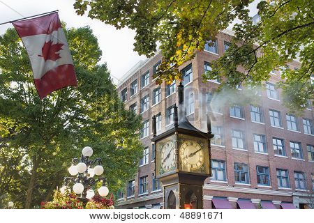 Steam Clock At Gastown With Canadian Flag