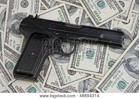 Black Gun With U.S. Hundred Dollar Bills