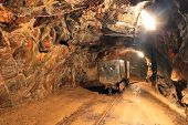 stock photo of mines  - Underground train in mine carts in gold silver and copper mine - JPG