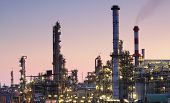 stock photo of greenpeace  - Oil refinery factory silhouette over sunset with pink sky - JPG