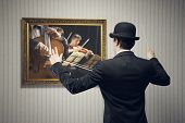 foto of orchestra  - Male orchestra conductor directing with his baton in concert conceptual image - JPG