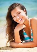 picture of suntanning  - Suntan Lotion Woman Applying Sunscreen Solar Cream - JPG