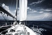 stock photo of sailing vessels  - Luxury sail boat in the sea at evening - JPG