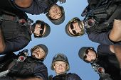 picture of policeman  - Low angle portrait of policemen standing against sky - JPG