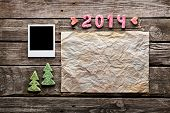 Sweet 2014 New Year holiday background. With blank instant photo frame, crumpled paper sheet and cut